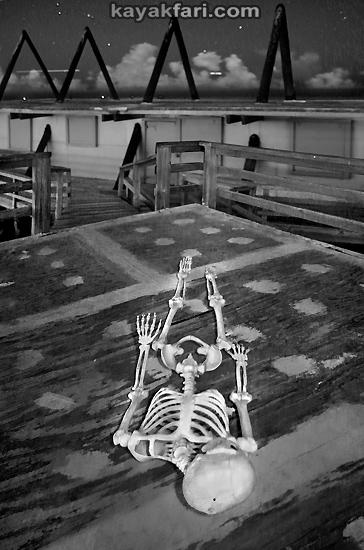 Flex Maslan halloween kayak Stiltsville Miami skeleton kayakfari art photography dark corpse kaya kay dead paddle night fright body bag surreal